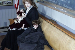 Mother & children sitting in Clive Railroad Depot.